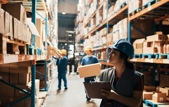 Workers organizing items in storage in a Commercial Warehouse in Peoria IL